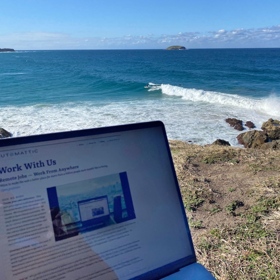 Sitting on a headland overlooking the surf and working